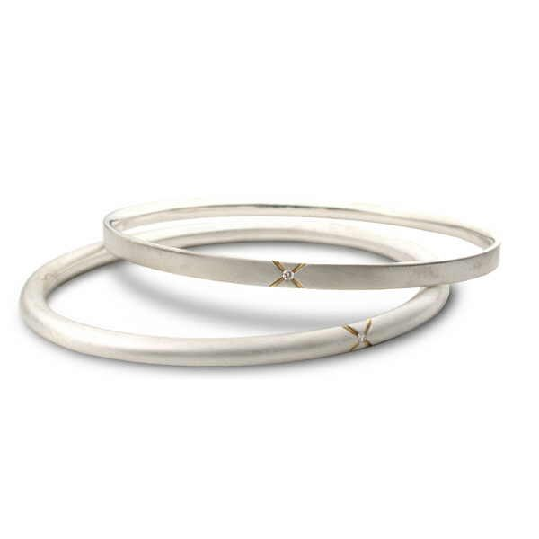 Diamond kiss bangles in silver and gold with diamonds