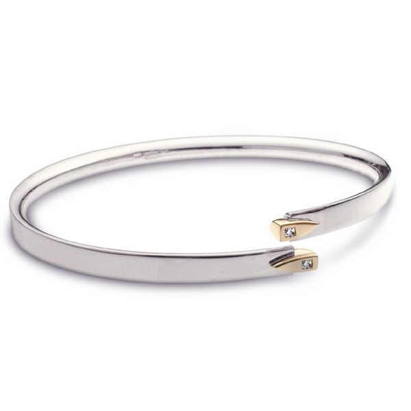 Diamond crossover bangle in silver and gold