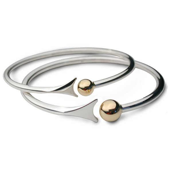 Unusual fishtail bangles in silver with gold beads