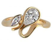 Calypso gold ring with pear shaped diamond