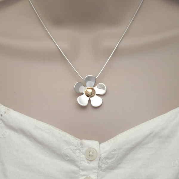 large daisy pendant on neck