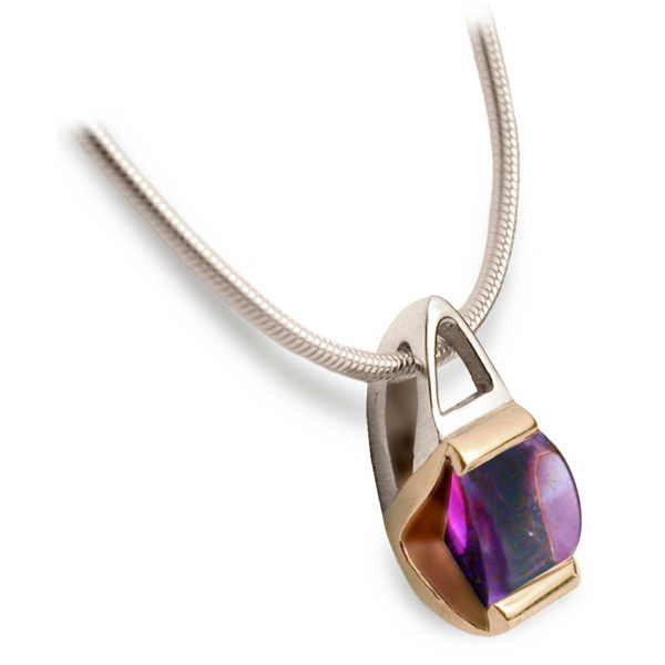 Silver and gold pendant with buff cut amethyst