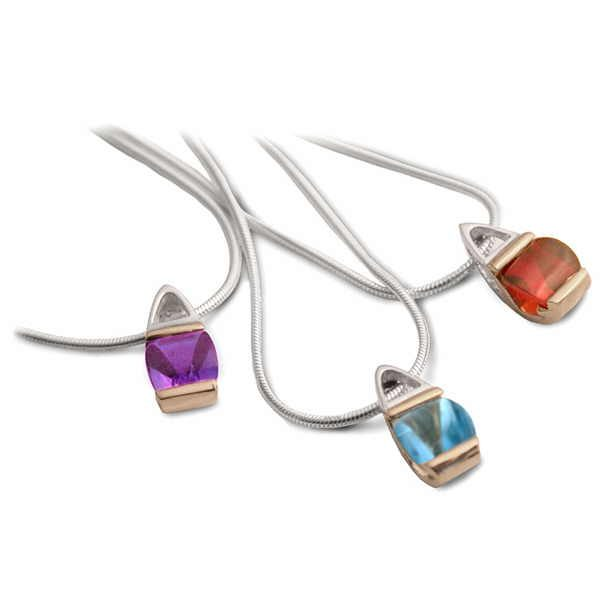 Stained glass pendants in silver and gold with buff cut stones