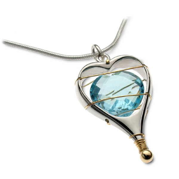 Silver and gold heart pendant with gem stone heart