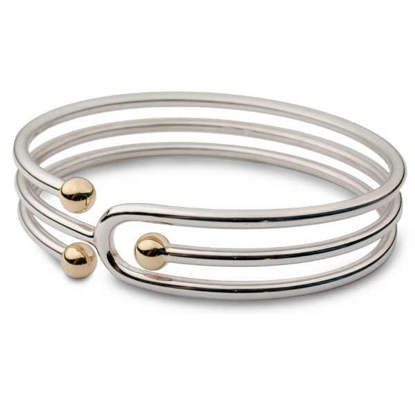 Unusual silver coil bangle with gold beads