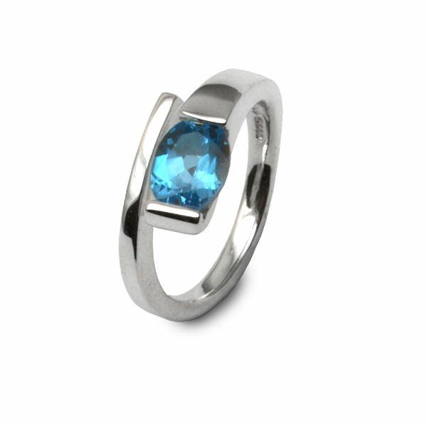 Silver torque ring set with oval gem stone