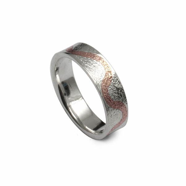 reticulated silver ring with rose gold detail