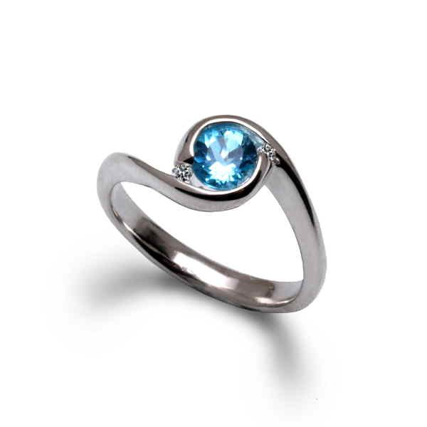 Orbit ring with blue topaz and diamonds