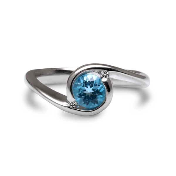 Orbit ring with blue topaz and diamonds, top view
