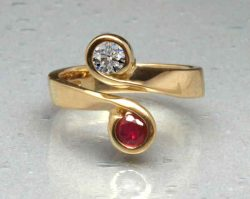 gold ruby and diamond crossover ring